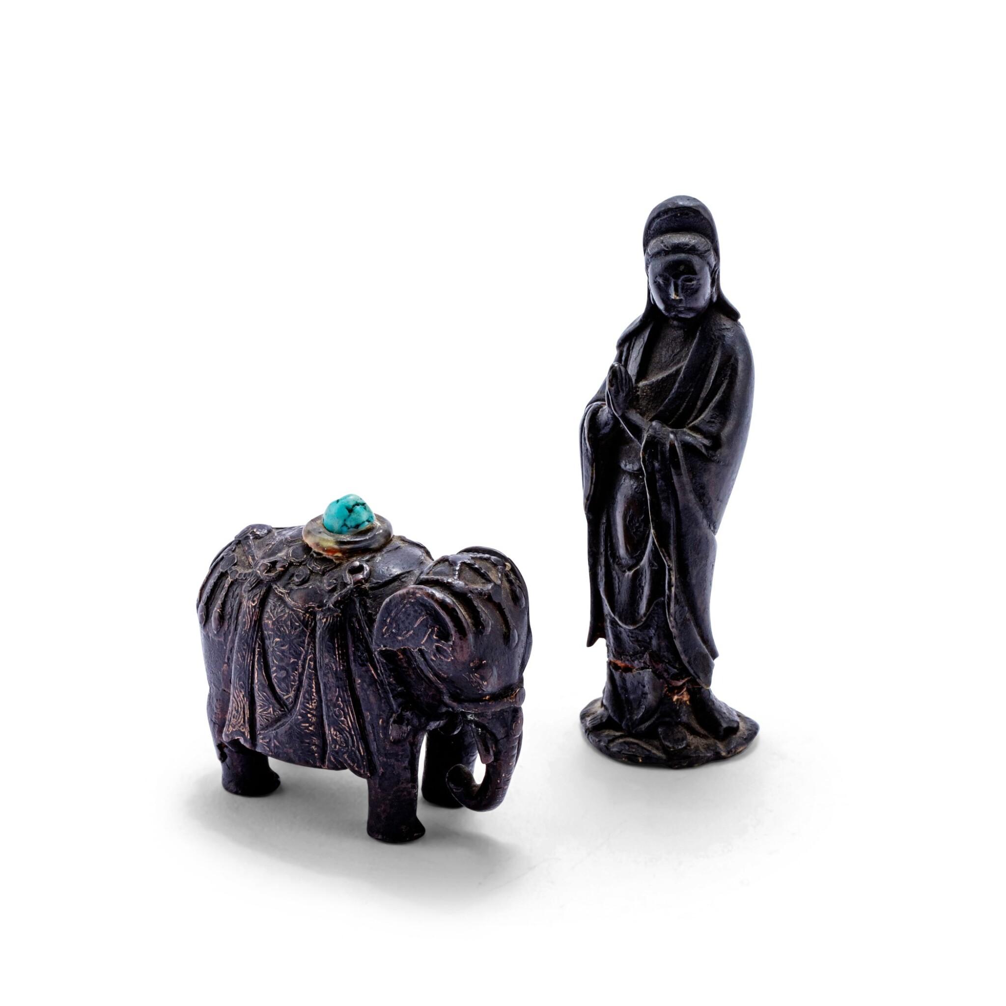 View 1 of Lot 71. Petite statuette de Guanyin en bronze patiné et presse-papier en forme d'éléphant Dynastie Qing, XVIIE- XVIIIE siècle | 清十七至十八世紀 銅觀音立像 及 銅象擺件 | A small bronze figure of Guanyin and a bronze 'elephant' paperweight, Qing Dynasty, 17th-18th century .