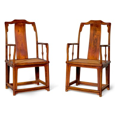 View 1. Thumbnail of Lot 107. A MAGNIFICENT PAIR OF LARGE HUANGHUALI CONTINUOUS YOKEBACK ARMCHAIRS, NANGUANMAOYI, LATE MING DYNASTY | 晚明 黃花梨南官帽椅成對.