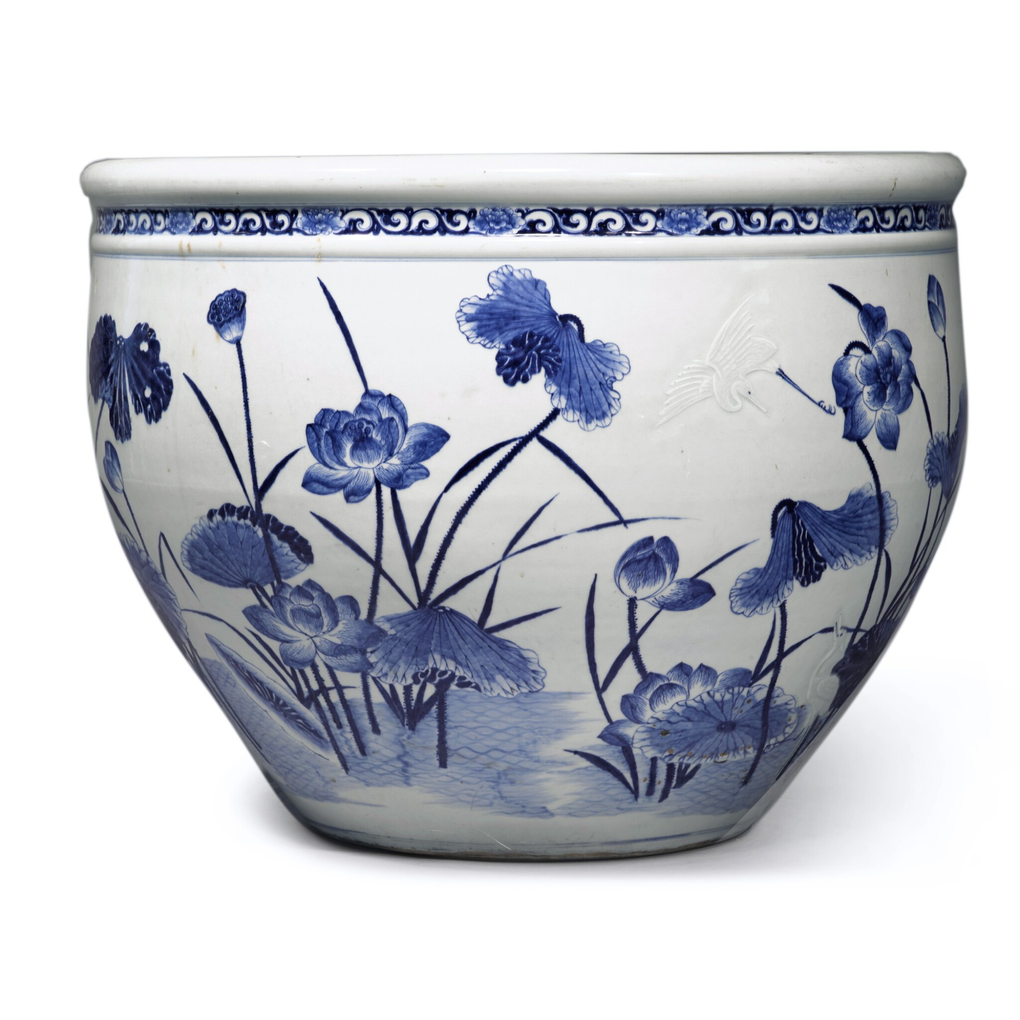 View full screen - View 1 of Lot 78. A large blue and white 'lotus pond' jardinière, Qing dynasty, 18th century | 清十八世紀 青花浮雕路路連科圖大缸.