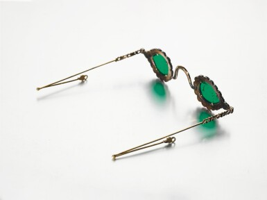 View 5. Thumbnail of Lot 213. A pair of Mughal spectacles set with emerald lenses, in diamond-mounted frames, India, lenses circa 17th century, frames 19th century.