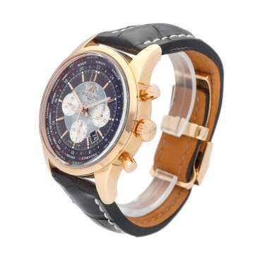 View 3. Thumbnail of Lot 69. Breitling Transocean Chronograph Unitime reference RB0510 A pink gold automatic chronograph worldtime wristwatch with date, circa 2012.