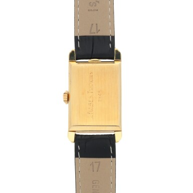 View 4. Thumbnail of Lot 402. PATEK PHILIPPE | REF 1559 YELLOW GOLD WRISTWATCH MADE IN 1944.