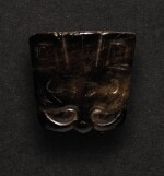 A SMALL BLACK JADE CARVING OF A TAOTIE MASK PENDANT SHANG DYNASTY OR LATER | 商或以後 玉饕餮紋珮