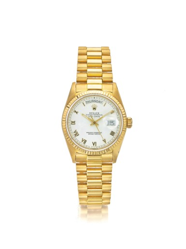 ROLEX | REF 18038 DAY-DATE, A YELLOW GOLD AUTOMATIC CENTER SECONDS WRISTWATCH WITH DAY DATE AND BRACELET CIRCA 1985