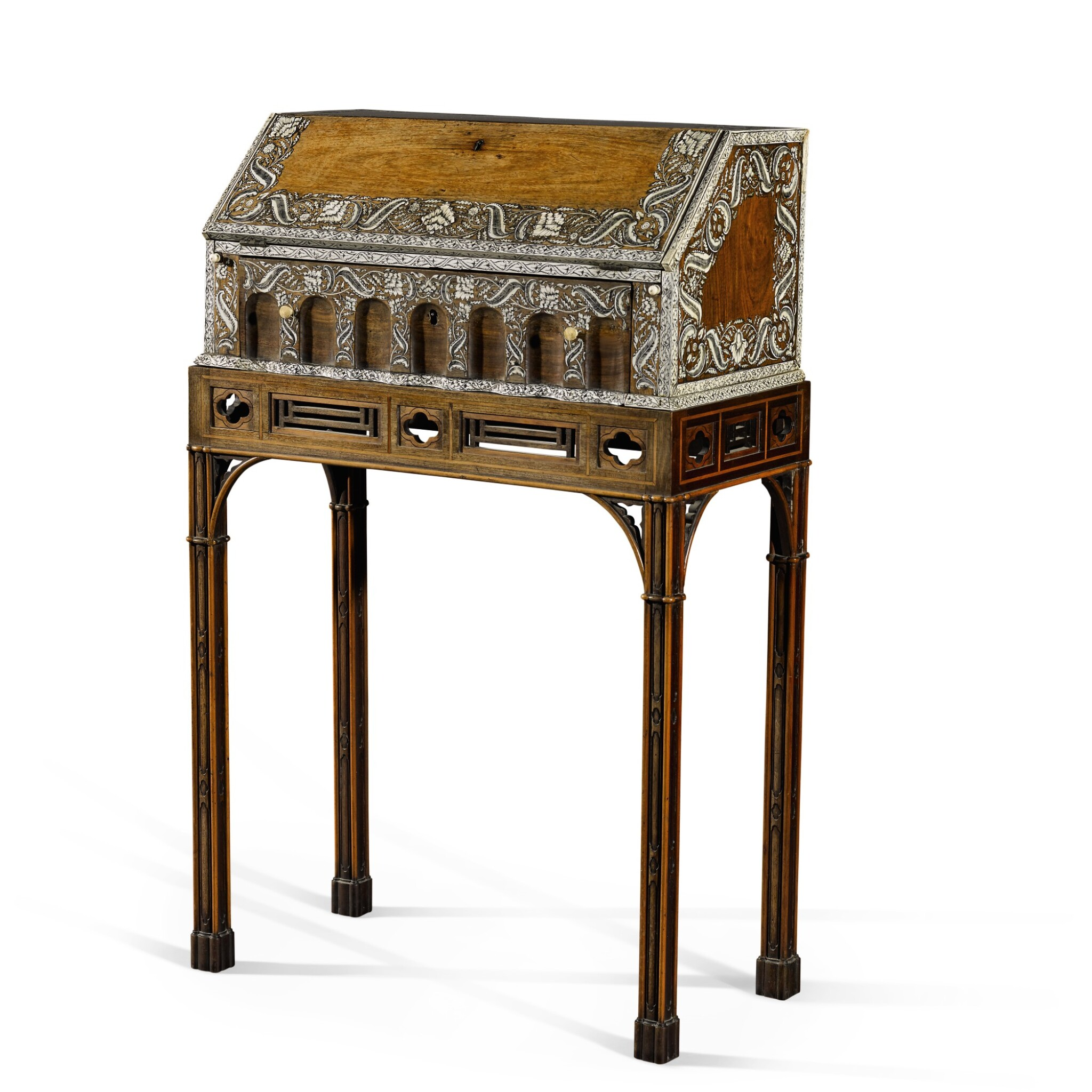 View full screen - View 1 of Lot 246. An Anglo-Indian rosewood and ivory inlaid table bureau on a mahogany and fruitwood stand by Thomas Chippendale, the bureau, Vizagapatam, circa 1740-50, the stand, London, 1767.