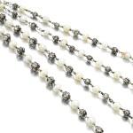 Natural pearl and diamond long chain, circa 1900