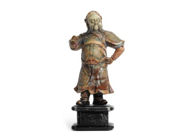 A POLYCHROME DECORATED SOAPSTONE FIGURE OF GUANDI | QING DYNASTY, 19TH CENTURY