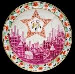 10 years USSR: a rare and large Soviet porcelain propaganda charger, Aleksey Vorobyevsky, Lomonosov Porcelain factory, Leningrad, 1927