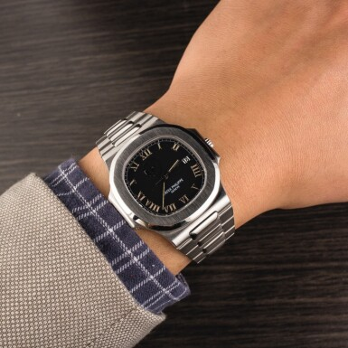 View 4. Thumbnail of Lot 17. PATEK PHILIPPE | Nautilus, Ref. 3710/1A, A Stainless Steel Wristwatch with Integrated Bracelet and Power Reserve Indicator, Circa early 2000s.