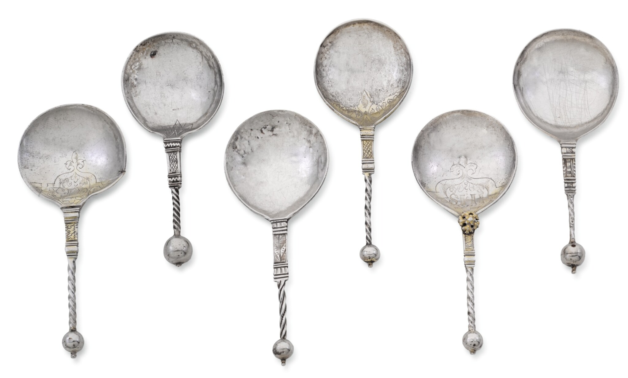 View full screen - View 1 of Lot 137. SIX NORWEGIAN SILVER AND PARCEL-GILT SILVER SPOONS, VARIOUS MAKERS AND TOWNS, CIRCA 1620/40.