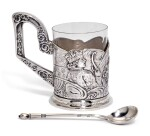 A silver tea glass holder and a spoon, 4th Artel, Moscow, and Grachev Brothers, St Petersburg, 1908-1917
