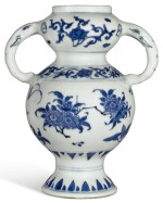 A BLUE AND WHITE ELEPHANT-HANDLED VASE TRANSITIONAL PERIOD | 明末清初 青花花卉紋象耳瓶