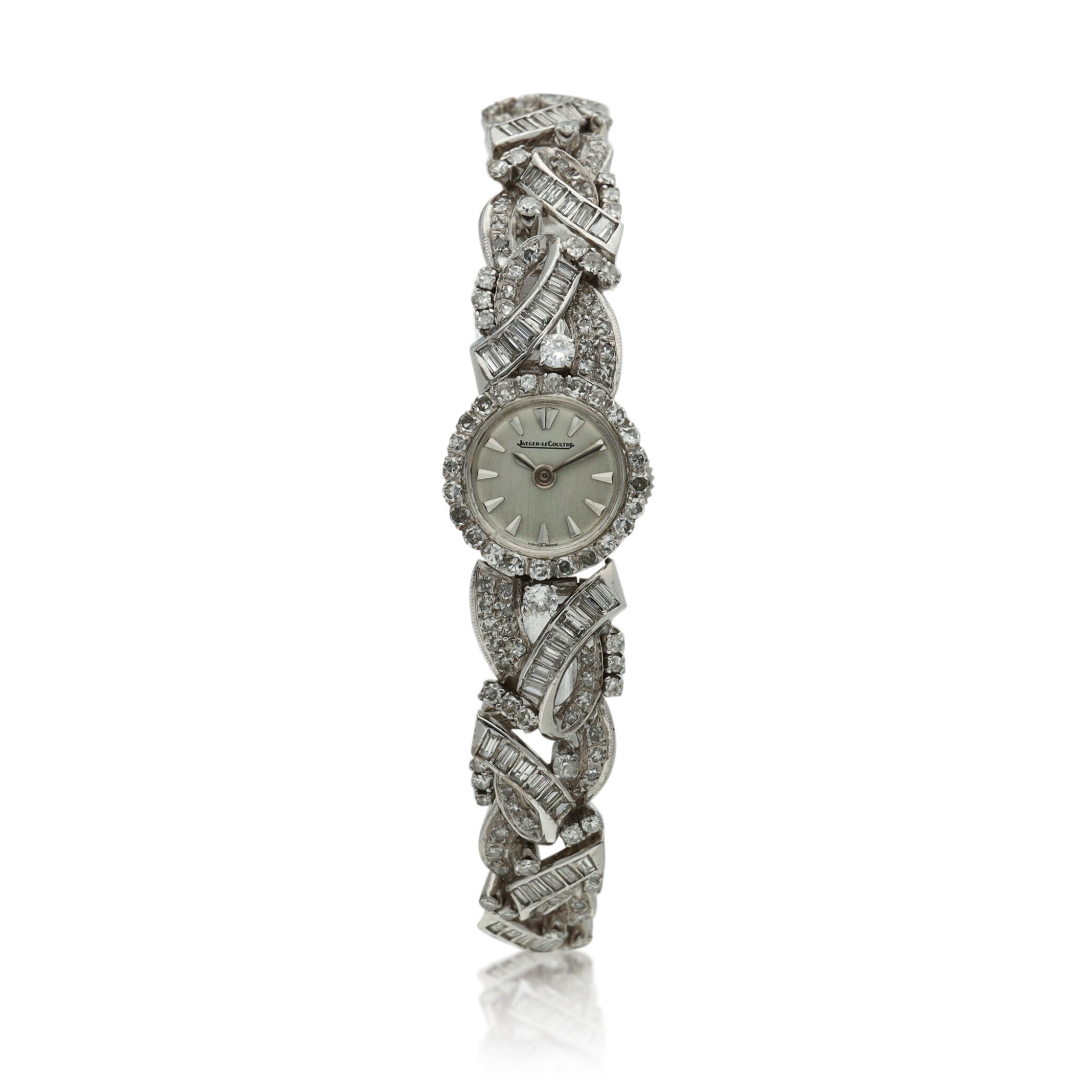 View full screen - View 1 of Lot 160. A lady's white gold and diamond-set backwind wristwatch, Circa 1960.