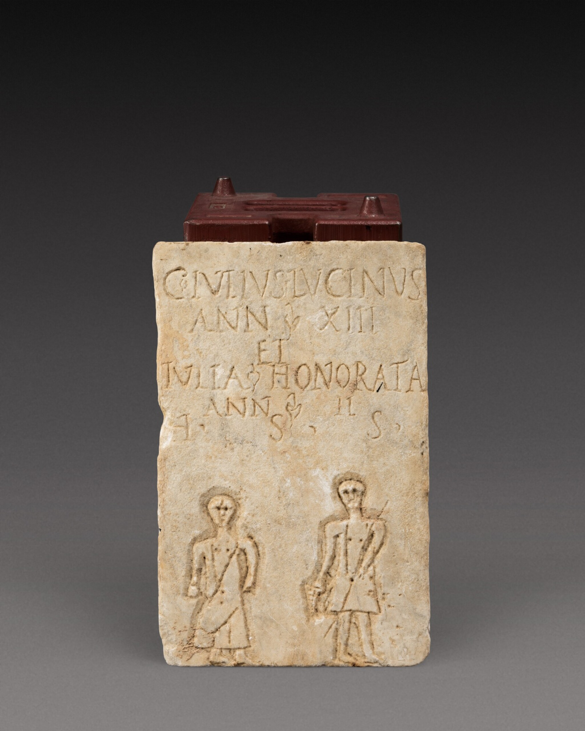 View 1 of Lot 105. A Roman Marble Funerary Plaque inscribed for Gaius and Julia, probably Gallo-Roman, circa 2nd/3rd Century A.D..