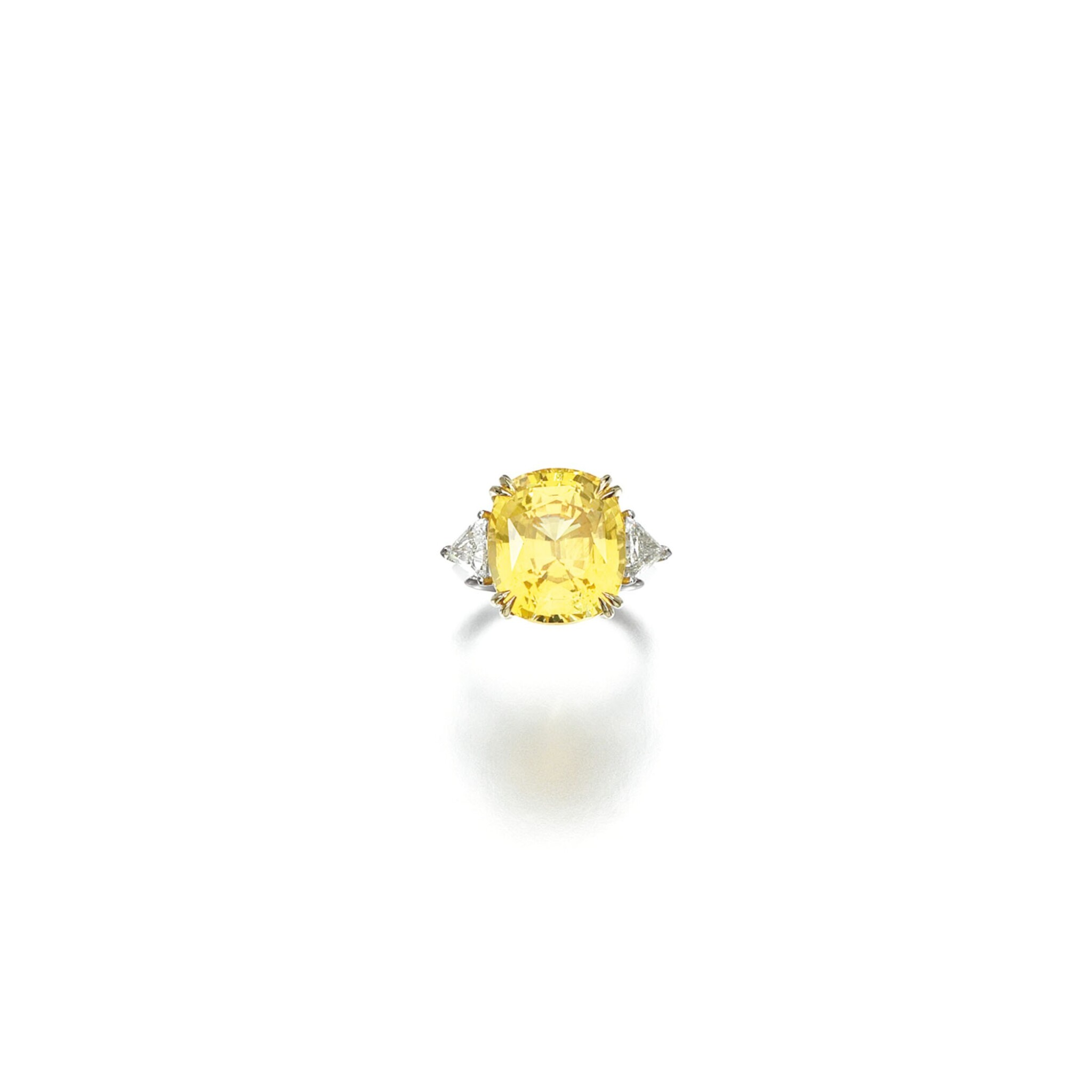 View 1 of Lot 23. YELLOW SAPPHIRE AND DIAMOND RING.