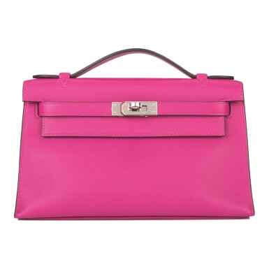 View 1. Thumbnail of Lot 16. Hermès Rose Pourpre Mini Kelly Pochette of Swift Leather with Palladium Hardware.