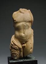 A ROMAN MARBLE TORSO OF DIONYSOS, CIRCA 2ND CENTURY A.D.