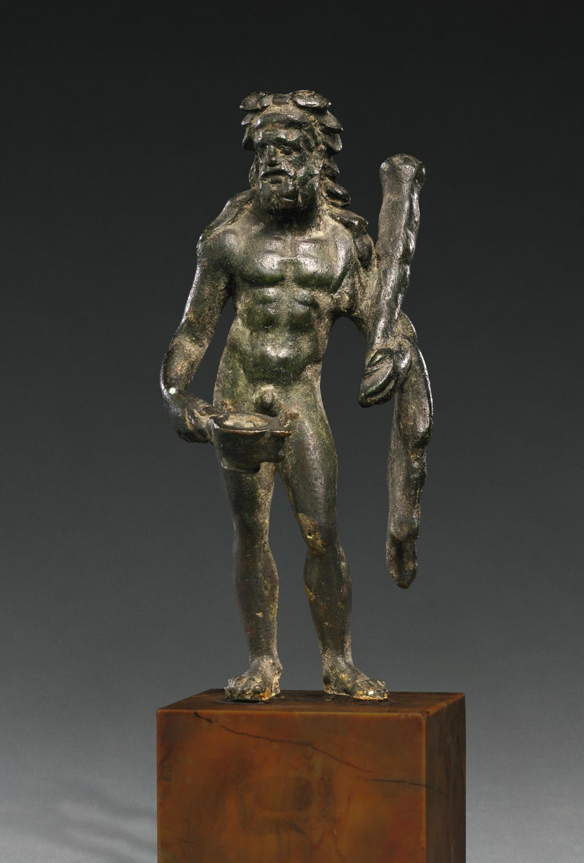 A ROMAN BRONZE FIGURE OF HERAKLES BIBAX, CIRCA 1ST CENTURY A.D.
