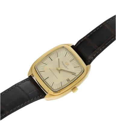 View 6. Thumbnail of Lot 92. REFERENCE R3003 A YELLOW GOLD TONNEAU SHAPED WRISTWATCH WITH DATE, CIRCA 1970.