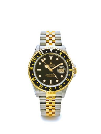 ROLEX | REF 16713 GMT-MASTER II, A STAINLESS STEEL AND YELLOW GOLD AUTOMATIC DUAL TIME ZONE WRISTWATCH WITH DATE AND BRACELET CIRCA 1990