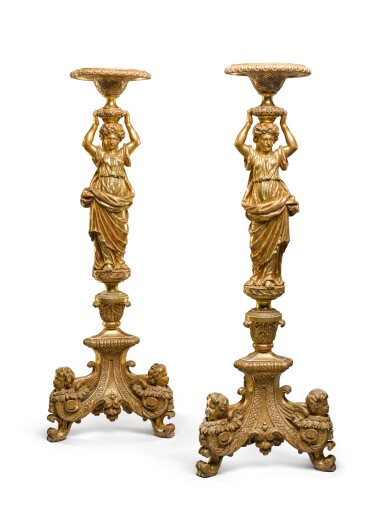 View 1. Thumbnail of Lot 30. A pair of George II carved giltwood torchères, second quarter 18th century, after a design by Alexis Loir.