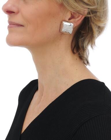 View 3. Thumbnail of Lot 134. Pair of diamond earclips (Paio di orecchini a clip con diamanti).