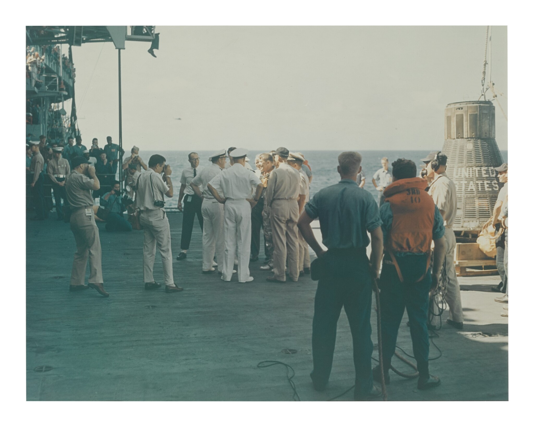 [MERCURY-ATLAS 8] VINTAGE CHROMOGENIC PRINT OF WALLY SCHIRRA ABOARD THE USS KEARSARGE AFTER SPLASHDOWN, 3 OCTOBER 1962.