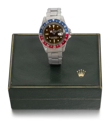 ROLEX | GMT-MASTER, TROPICAL EXCLAMATION POINT DIAL WITH EAGLE BEAK CROWN GUARDS, REFERENCE 1675,  STAINLESS STEEL DUAL-TIME WRISTWATCH WITH DATE AND BRACELET,  CIRCA 1961