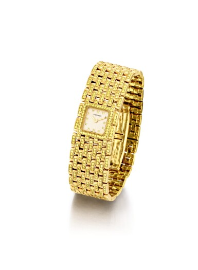 """View 2. Thumbnail of Lot 2053. CARTIER   PANTHÉRE, REFERENCE 2449, A UNIQUE YELLOW GOLD AND YELLOW DIAMOND-SET BRACELET WATCH, MADE ON SPECIAL REQUEST, CIRCA 2000   卡地亞   """"Panthére 型號2449 獨一無二黃金鑲黃鑽石鏈帶腕錶,為特殊訂製,錶殼編號99851CD,約2000年製""""."""