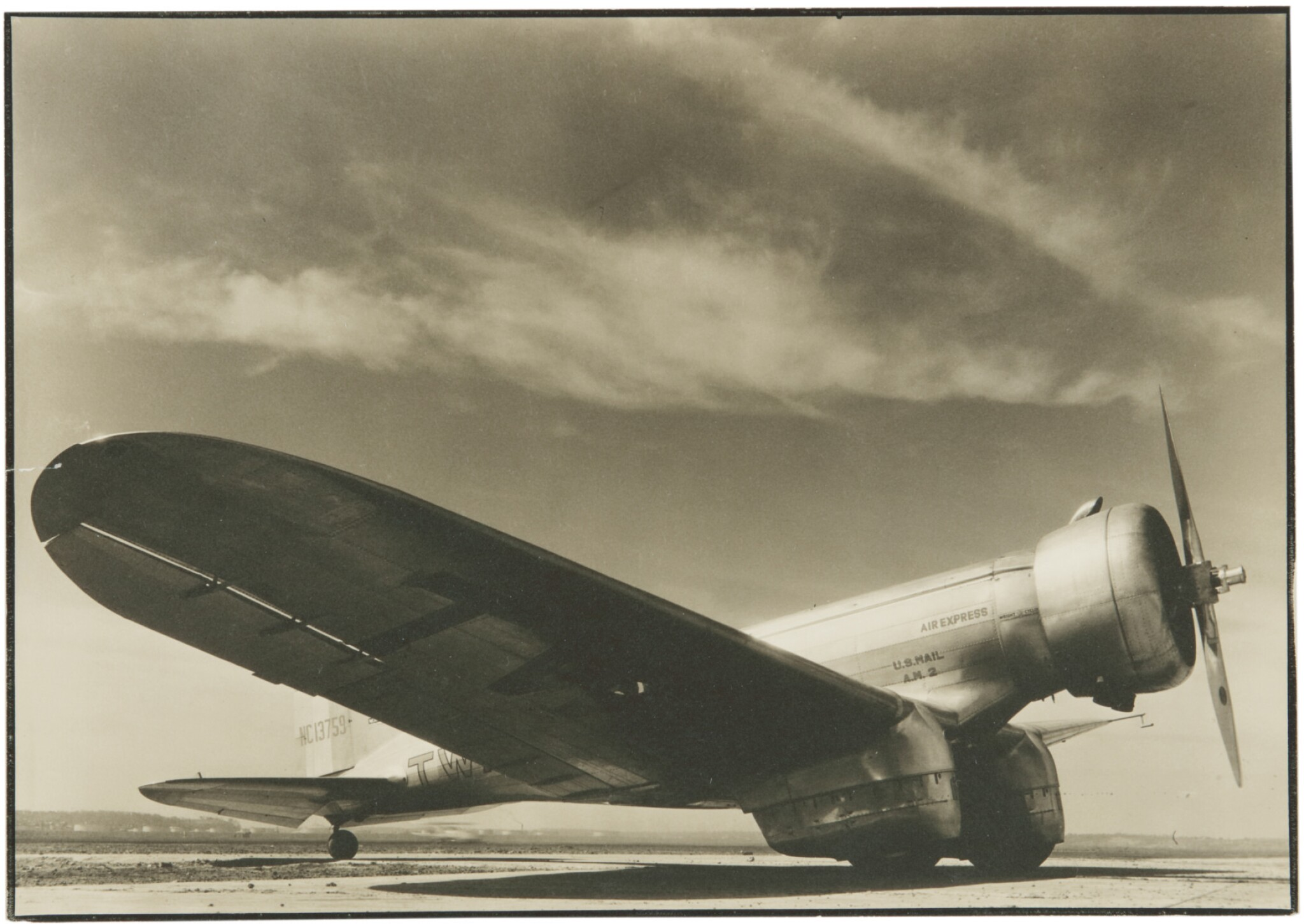 View full screen - View 1 of Lot 59. MARGARET BOURKE-WHITE | TWA AIRPLANE ON THE TARMAC.