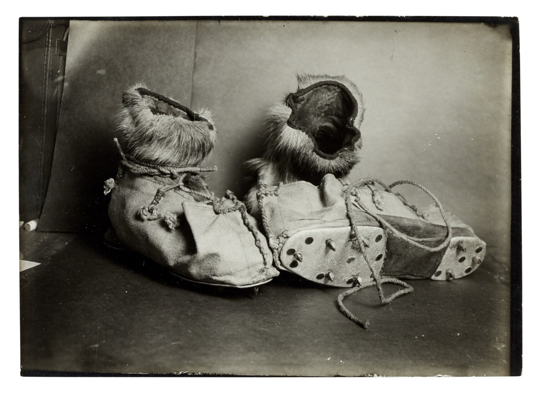 View full screen - View 1 of Lot 189. Herbert Ponting   Three original photographs of ski shoes, published in 'Scott's Last Expedition', 1913.