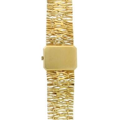 View 5. Thumbnail of Lot 65. Reference 8272 De Ville Designed by Gilbert Albert: A yellow gold rectangular bracelet watch, Circa 1965.