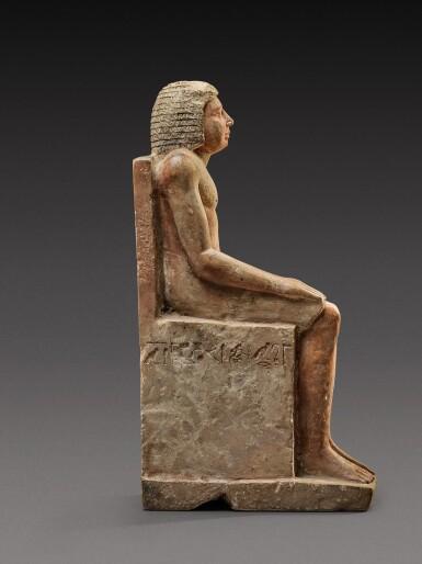View 4. Thumbnail of Lot 54. An Egyptian Polychrome Limestone Figure of Hem-Min, 6th Dynasty, 2360-2195 B.C.  .