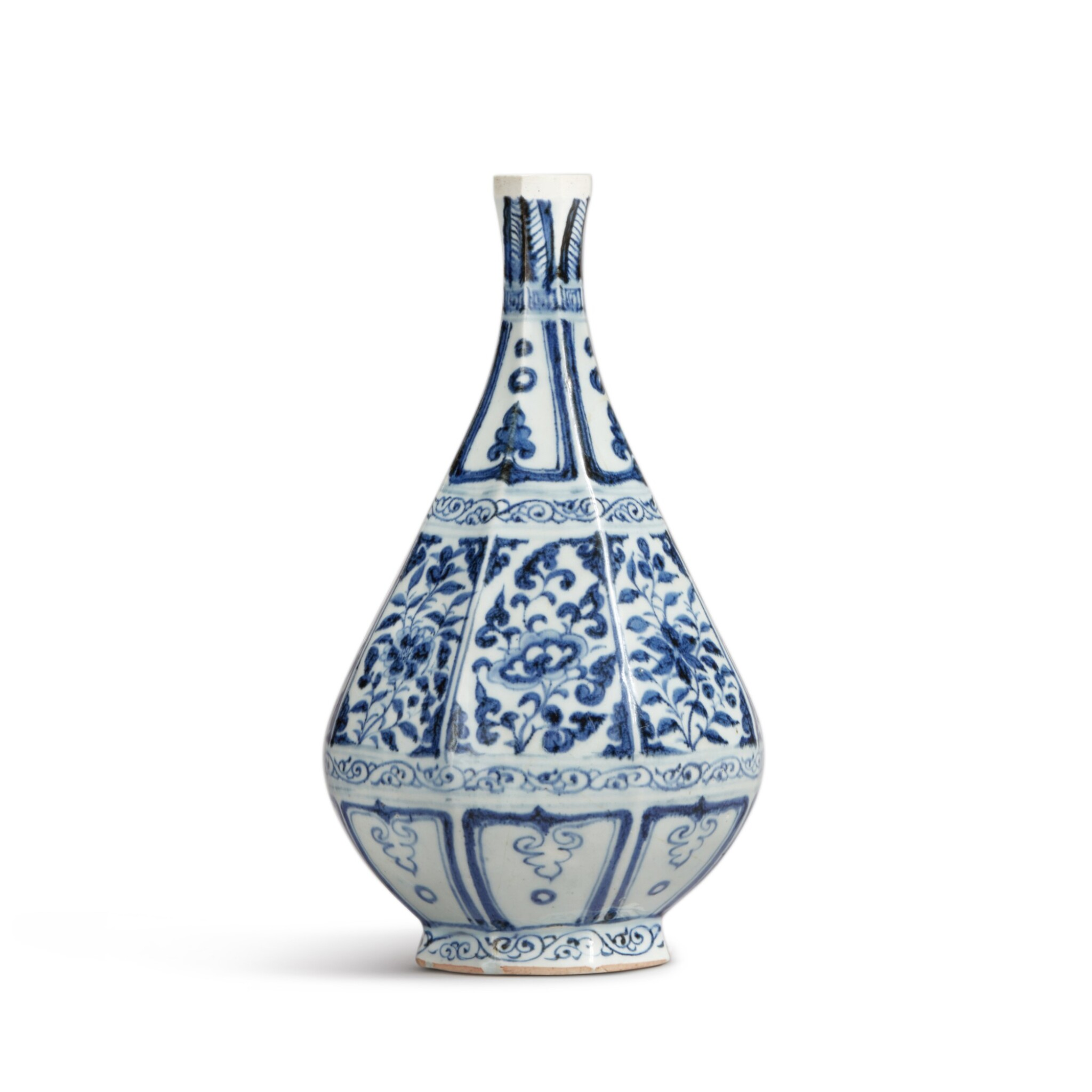View full screen - View 1 of Lot 93. A blue and white faceted pear-shaped vase, Yuan dynasty | 元 青花花卉紋八棱玉壺春瓶.