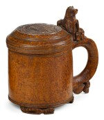 NORWEGIAN, CIRCA 1800 | Tankard carved with Lions