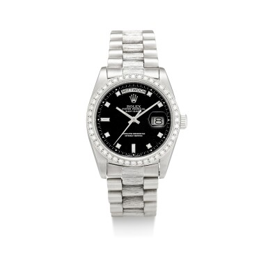 View 1. Thumbnail of Lot 1107. ROLEX | DAY-DATE, REFERENCE 1803, A WHITE GOLD AND DIAMOND-SET WRISTWATCH WITH DAY, DATE, BRACELET AND LATER RODIUM-PLATED BEZEL, CIRCA 1982.