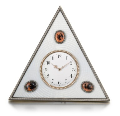 View 1. Thumbnail of Lot 25. A Fabergé jewelled silver, agate and guilloché enamel desk clock, workmaster Michael Perchin, St Petersburg, circa 1902.