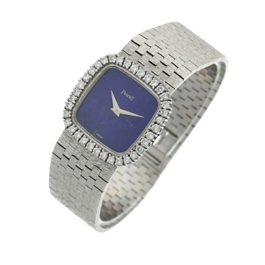 View 2. Thumbnail of Lot 111. A white gold and diamond-set cushion shaped bracelet watch with lapis lazuli dial, Circa 1970.