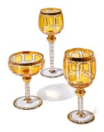 A BOHEMIAN AMBER-TINTED AND GILT GLASS PART-TABLE SERVICE, LATE 19TH/20TH CENTURY