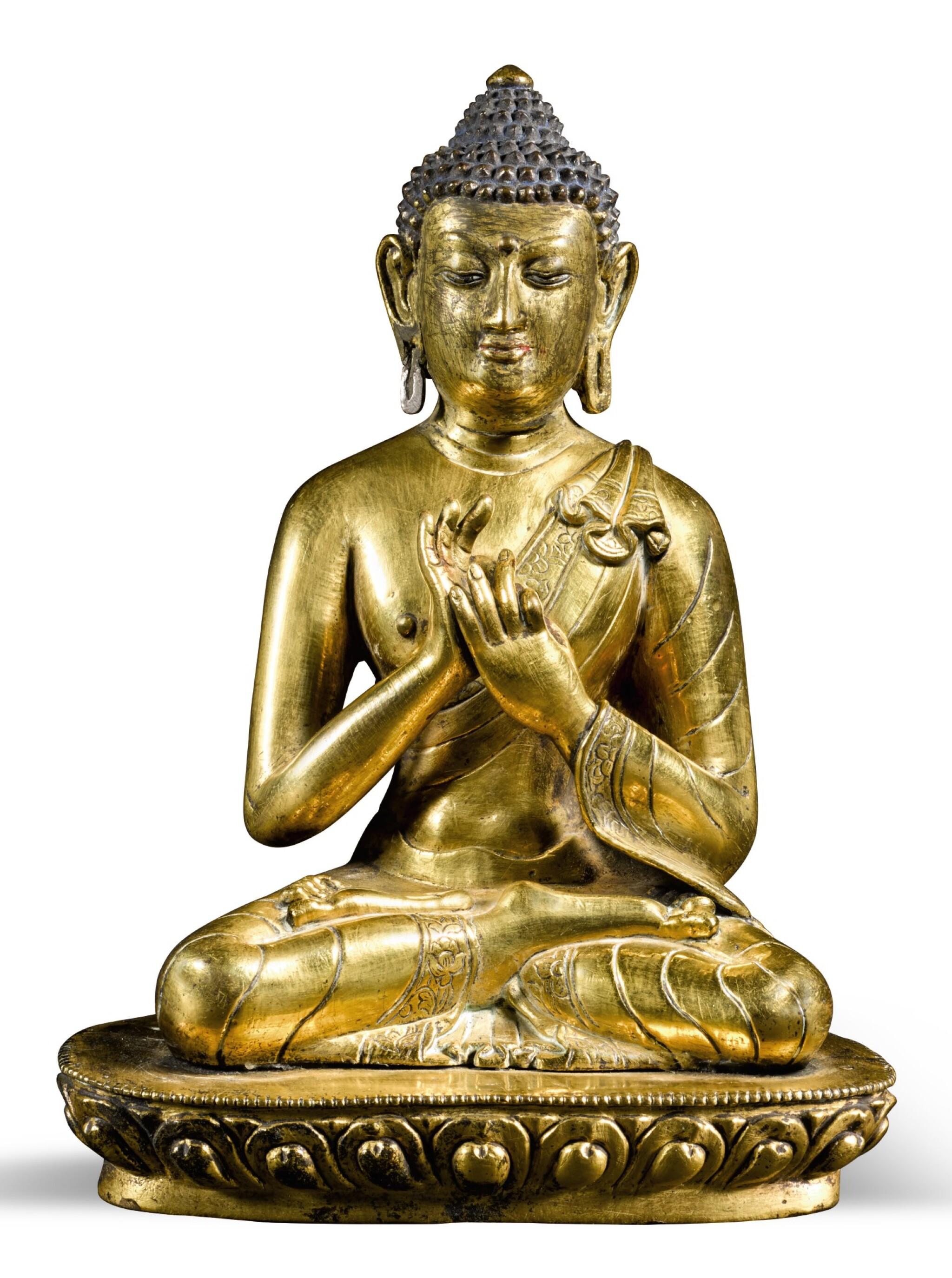 View full screen - View 1 of Lot 258. A GILT COPPER-ALLOY FIGURE OF A DHARMACHAKRA BUDDHA TIBET OR NEPAL, 18TH/19TH CENTURY | 十八/十九世紀 尼泊爾或西藏 鎏金銅佛坐像.