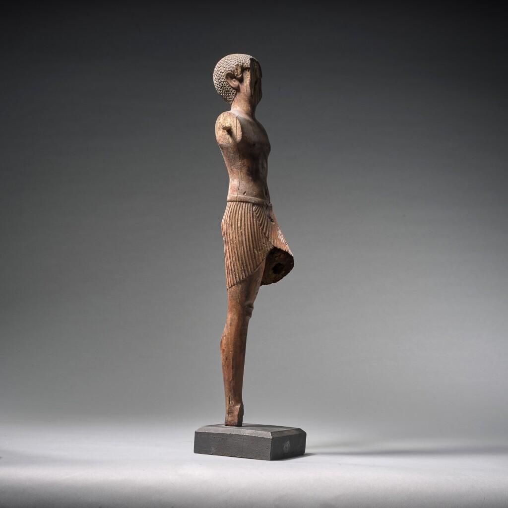 AN EGYPTIAN WOOD FIGURE OF A MAN, CIRCA 11TH/EARLY 12TH DYNASTY, CIRCA 2081-1900 B.C.