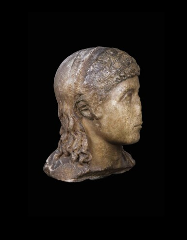 View 4. Thumbnail of Lot 66. A Roman Marble Portrait Head of a Boy, circa 2nd half of the 1st Century A.D..