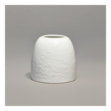 A WHITE-GLAZED CARVED 'BEEHIVE' WATERPOT,  KANGXI MARK AND PERIOD