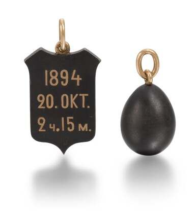 View 2. Thumbnail of Lot 2. Two Imperial Fabergé gold and gunmetal pendants, the shield pendant, workmaster Michael Perchin, St Petersburg, circa 1894.