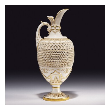 A ROYAL WORCESTER RETICULATED PORCELAIN EWER BY GEORGE OWEN 1909