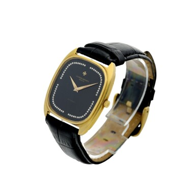View 2. Thumbnail of Lot 804. REFERENCE 44003 A YELLOW GOLD CUSHION SHAPED AUTOMATIC WRISTWATCH WITH DIAMOND-SET ONYX DIAL, CIRCA 1985.