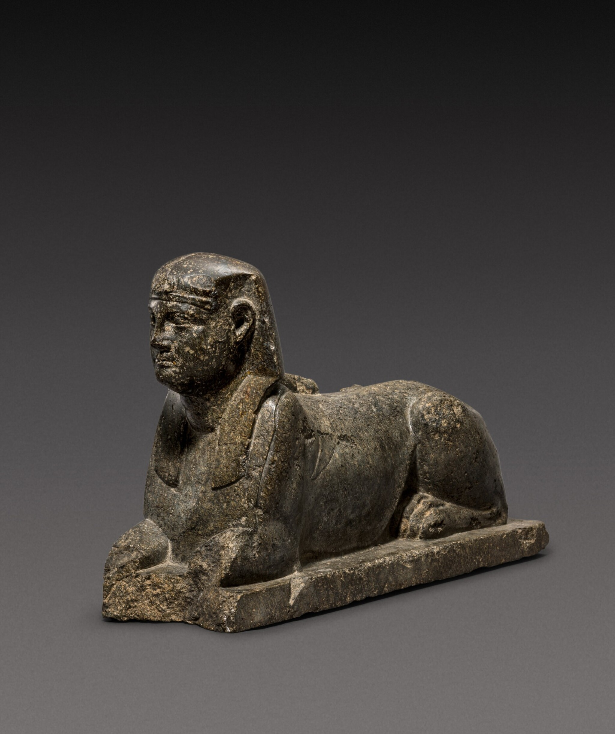 View full screen - View 1 of Lot 44. An Egyptian Figure of a Sphinx, Ptolemaic Period, 305-30 B.C..