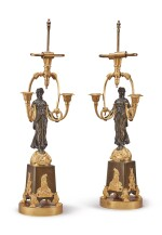 A PAIR OF EMPIRE PATINATED AND GILT BRONZE THREE-LIGHT CANDELABRA, EARLY 19TH CENTURY