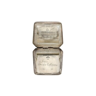 View 6. Thumbnail of Lot 100. A silver purse shaped travel clock, Circa 1930.