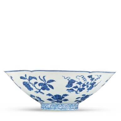 View 4. Thumbnail of Lot 131. A finely painted blue and white lobed 'fruit and flower' bowl, Xuande mark and period | 明宣德 青花折枝花果紋葵口碗  《大明宣德年製》款.